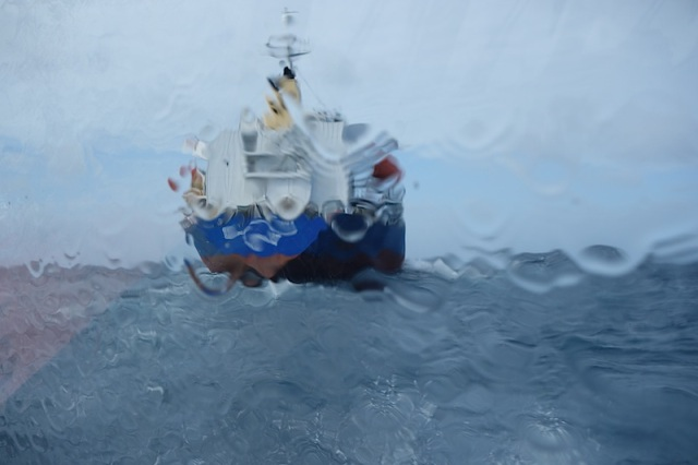 Pilot boat awash. Passing by the stern of the cargo ship we rendezvoused with.