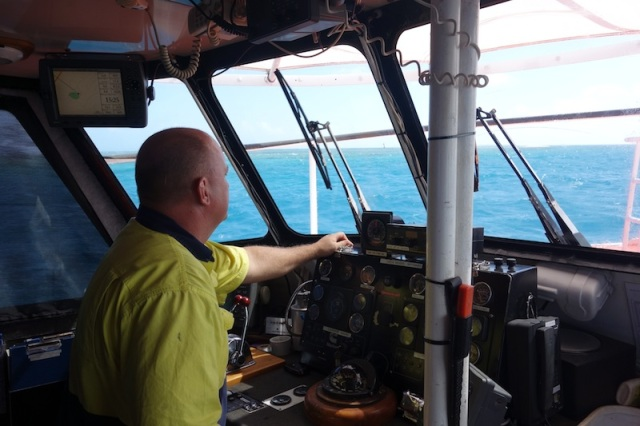 Captain Mark at the helm of P.V. Archer.