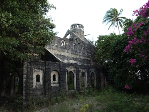 The Poruma (Coconut Island) Church of St Andrews. The foundation stone was laid in 1926 and the building reached bell tower stage before construction ceased.