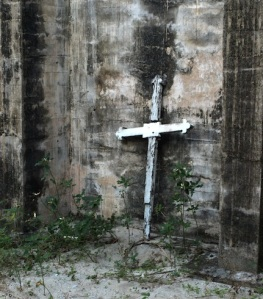A cross standing guard in the ruins of St Andrews.
