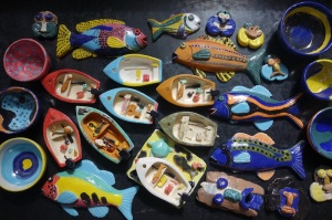 Finished work…fish, bowls, boats and masks. These pieces were fired in an electric kiln on Thursday Island.