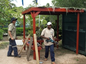 Tim and one of his students putting the finishing touches to the school garden shop.