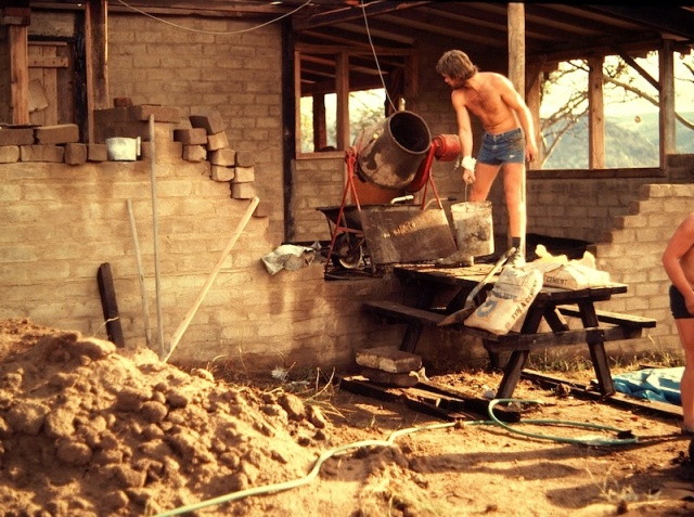 Building our mudbrick house. Our English friend Bill making mortar and laying up the bricks. Bill now lives in the US and writes comments on this blog.