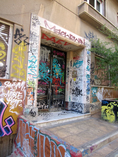 Athens. This graffiti could in no way be considered art; it is blatant vandalism. Imagine how upset you would be if this was your front door.