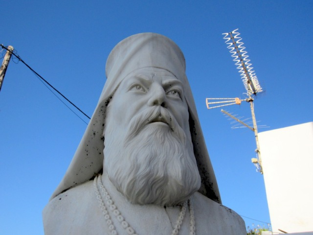 Bishop Eftymios Karathas outside Lariotissa Church in Potamos. Tuning into the BBC?