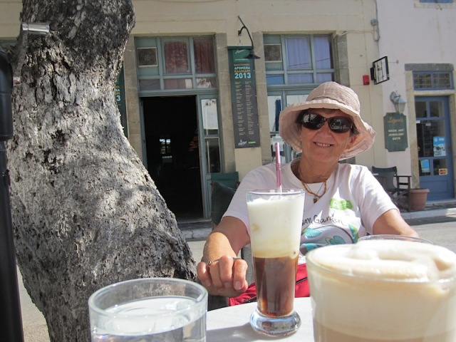 Bev sitting on the opposite side of the road outside the very same café sixty-six years later!