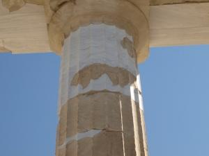 Doric order column showing restoration efforts.