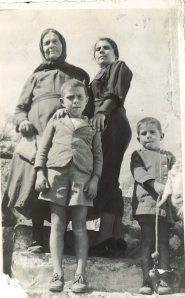 From left to right. Yiayia Stavroula (Aleko's grandmother). Metaxia, Aleko and Tzaneto. I do like the low camera angle.