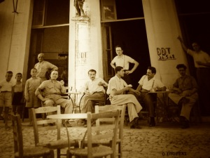Relaxing after the war outside Livaditis Kafeneion  (now Astikon) Potamos.  It was in this café that the freedom fighters used to meet and discuss their plan of action.  Copyright Emm.Sofios.