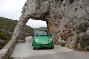 Road out of the monastery passing through a granite arch.