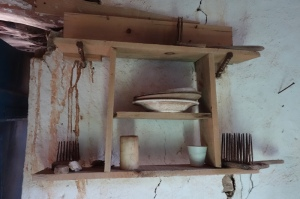 A local time capsule in an old cottage on Kythera. The small rakes on the bottom shelf were used for removing olives from tree branches.