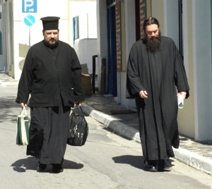 Greek Orthodox priests going home for lunch after a hard morning in the office.