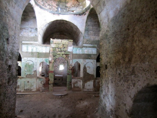 The interior of the Agia Varvara Paleochora. Photograph taken through a crack in the door.