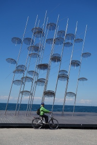 Creative stainless steel mesh umbrella sculpture along the boulevard.