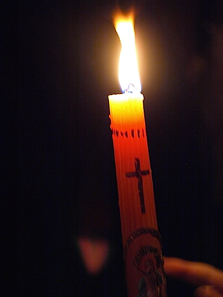 Burning one of the precious candles.