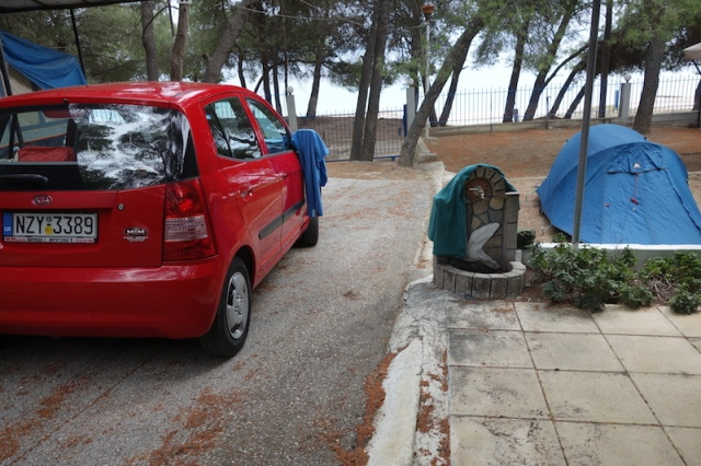 Our little red hire car and our first camp.