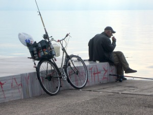 Fisherman and his specially equipped fishing bike.