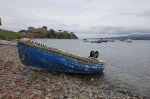 A moulded fibreglass imitation clinker-style boat.