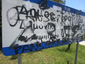 Graffiti-obliterated road sign.
