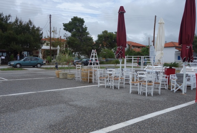 Restaurants set up tables and chairs outside for the summer.