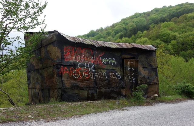 Flattened oil drum shed on the way to Serres.