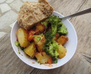 Potato, broccoli, carrot and tomato brew up.