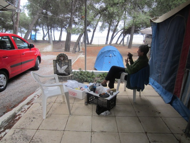 Our cooking and dining area under a caravan awning. We were grateful to the owners for the awning as it sheltered us from the rain.