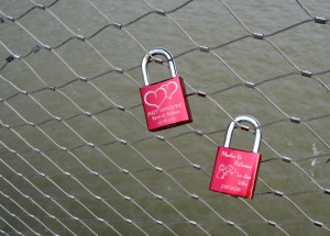 Lovers' locks on the bridge.  I'm wondering if the lovers split do they unlock the lock and throw it in the river.
