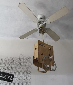 A very creative lampshade configuration. I think the drive sprocket attached to the bag was to stop it from flipping up when the fan was going.