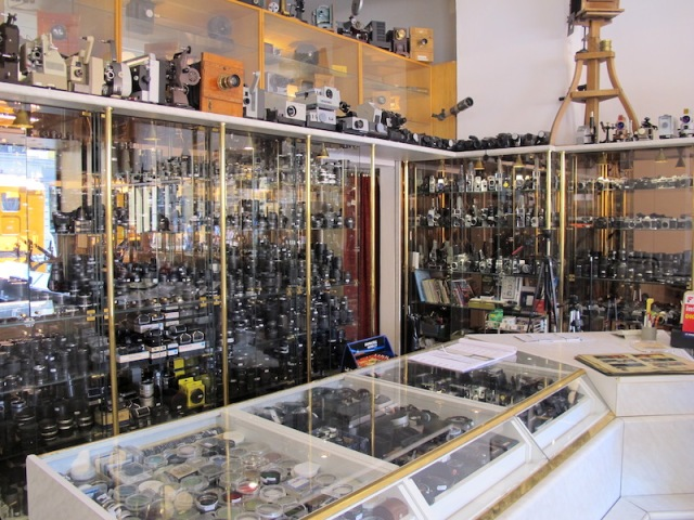 Showcases full of lenses, filters, cameras, slide and film projectors.