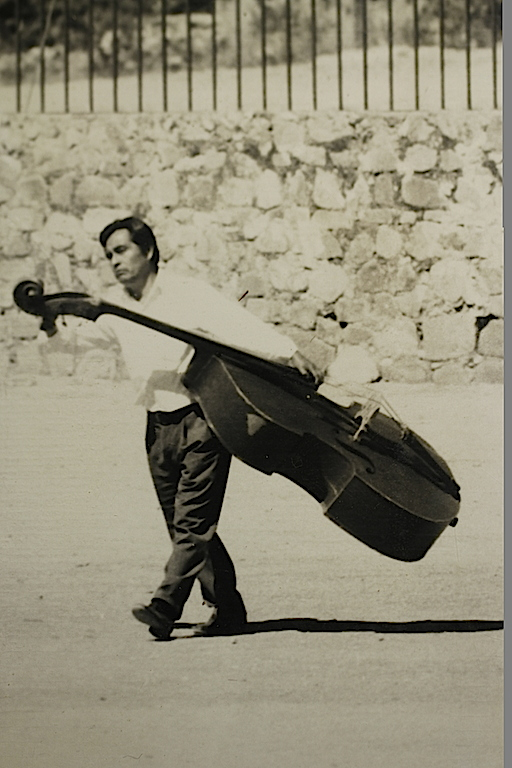 Mexican taking a bull fiddle for a walk. One of my B & W photographs processed over forty years ago.