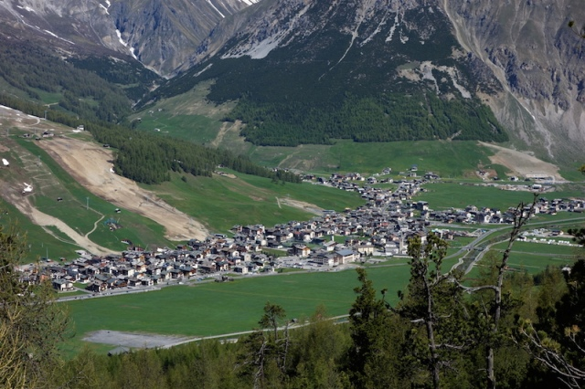 Livigno Italy. The bare earth running down to the village is a new ski run being developed.