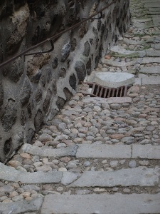 Cobblestone wall and pavement in Le-Puy, France.  Cobblestones are water-worn beach or river stones and their shape enabled horse hooves to grip.