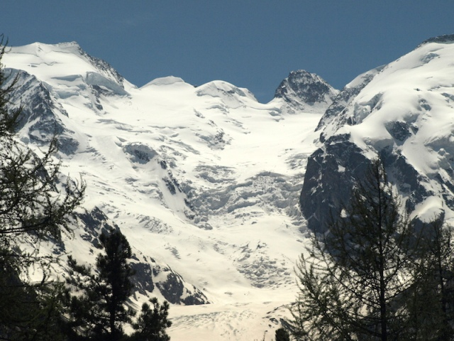 The Morteratsch glacier. The glacier face is the vertical face of ice to the left of the cliff face middle right.