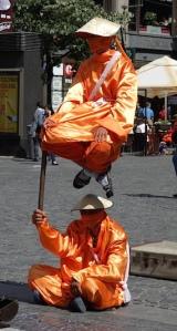 A balancing busker.
