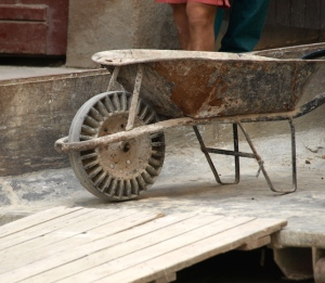 ……a plastic-wheeled wheelbarrow. If I had one of these I would never have to fix a flat tyre on a wheelbarrow again.