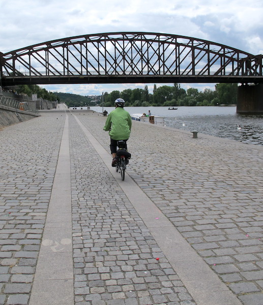 Local authorities efforts to provide a bump free bike path. Granite slabs are a smoother ride than cobblestones. The Vltava (Moldau) riverside path.