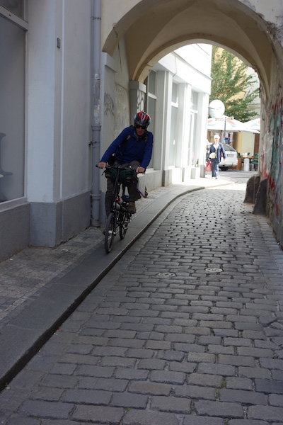 Riding the curb was smoother than the cobblestones, it took some balancing though.