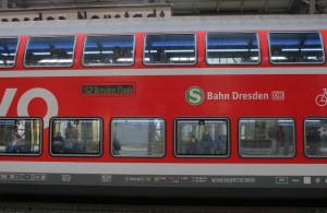 A train carriage on an adjoining platform. The reflections in the windows are like paintings on a gallery wall, art is everywhere.