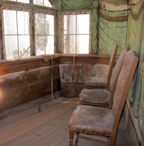 Inside one of the private boxes. Can you imaging the gentry and their ladies sitting on these chairs?