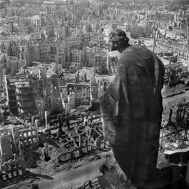 Destroyed Dresden 1945. The surviving figure in the foreground is the allegory of goodness. Fotothek Blik vom Rathaustrum via Wikipedia. Richard Peter-Deusche Fotothek.