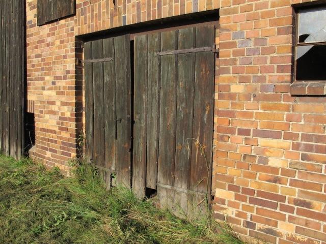 Barn doors. Note the cat hole in the door.