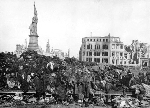 Piles of bodies prior to cremation. From Bundesarchive via Wikipedia..