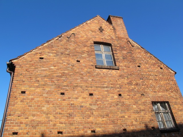 Gable end of the house. The holes in the wall were where timber scaffolding was placed during construction.