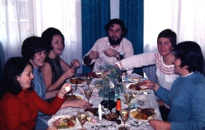 Christmas dinner with friends in Belgrade. Bev on the right with arm extended across the table.