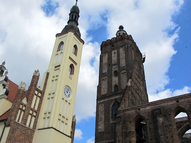 The twin towers of the Parish Church tower (right) and the restored Town Hall tower.