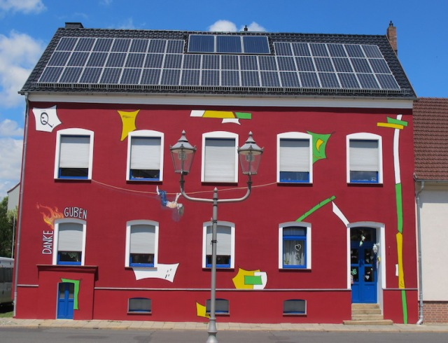 A Guben building bursting with colour. Note the solar panels on the roof.
