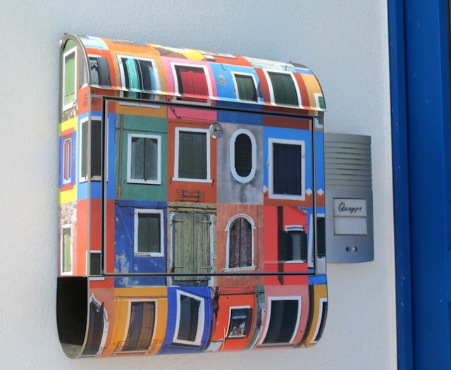 The colourful letterbox on the colourful house.