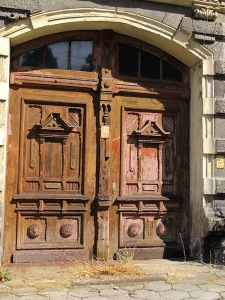 The front doors of the mansion, a restorer's delight.  I suspect this entranceway led to stables.