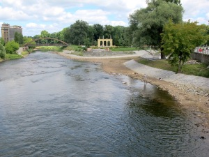 The border of Germany and Poland, looking downstream (north).  Germany is on the left bank and Poland on the right.  The arches are standing on Theatre Island.
